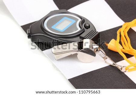 Checkered finish flag with whistle and stopwatch isolated on white