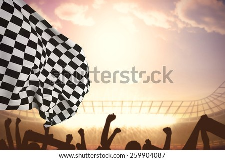 Checkered flag against football stadium with cheering crowd