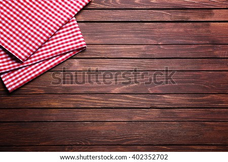 Checkered napkin on wooden background #402352702