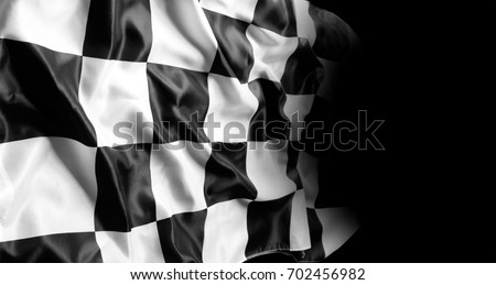 Checkered racing flag on black