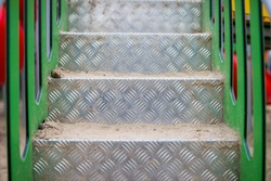 checkered steel stairs on the playground