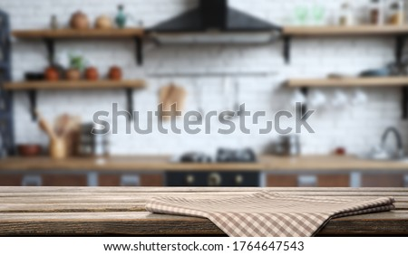 Checkered towel on wooden table in kitchen. Space for text Stockfoto ©