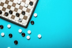 checkers Board and checkers played on a blue background