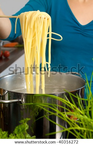 Checking al dente for pasta