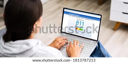 Checking Credit Score Ranking On Laptop Computer Stock photo ©