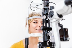 Checking eyesight with Slit lamp, examination of the eyes in an ophthalmology clinic