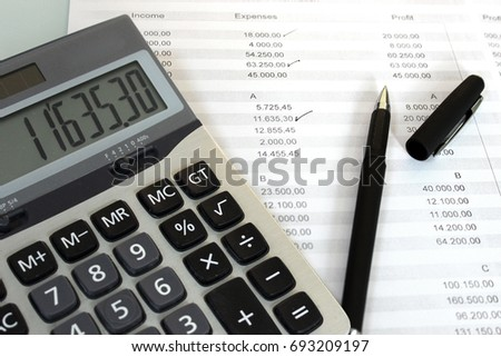 Checking the Accounts with calculator