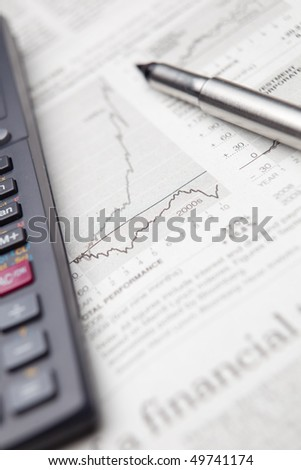 checking the situation on the financial markets in a newspaper