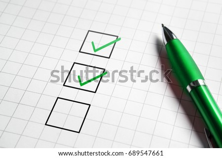 Checklist and to do list with v sign check marks in square box. Pen and paper. Project management, planning and keeping score of completed tasks concept.