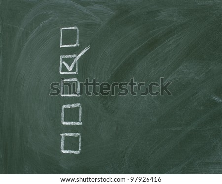 Checklist at the blackboard with copy space