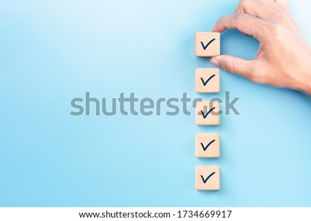 Checklist concept, Check mark on wooden blocks, blue background with copy space Photo stock ©