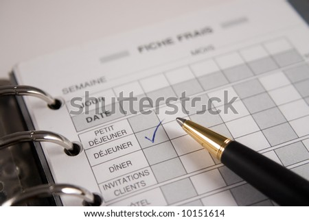 Checklist in an agenda with a black pen