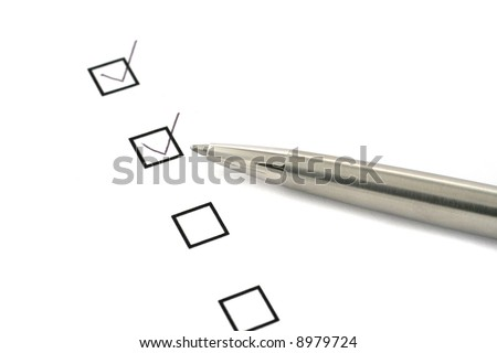 checklist on white paper and silver pen