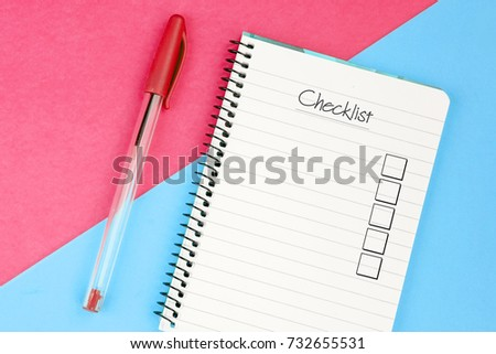 Checklist with check box written on a notebook #732655531