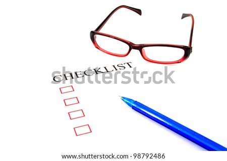 Checklist with pen, glasses and checked boxes.