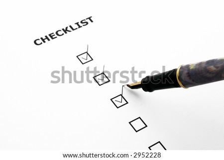 checklist with three boxes ticked and a pen
