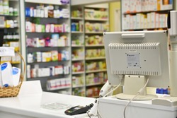 Checkout the pharmacy. Interior pharmacies and blurred background. Drugs and vitamins in pharmacies Boxes of medicines on the shelves.