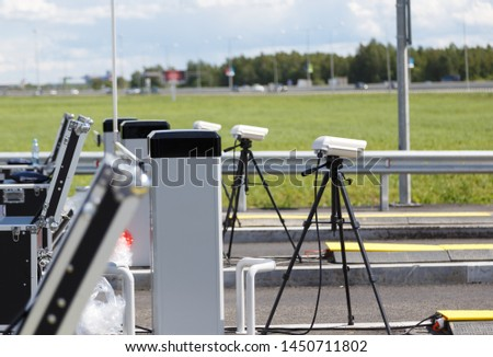 checkpoint police on the road. cameras on tripods and equipment in cases for inspection of entering cars on the road. Pre-entry inspection .