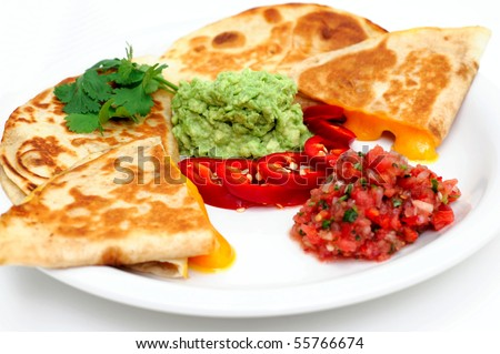 Cheddar cheese quesadilla's with guacamole fresh salsa and sliced red ...