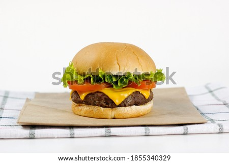cheddar cheeseburger with tomato and lettuce Сток-фото ©