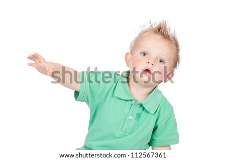 Cheeky and cute blond hair blue eyed baby boy in green polo shirt and spiky mohawk hairstyle