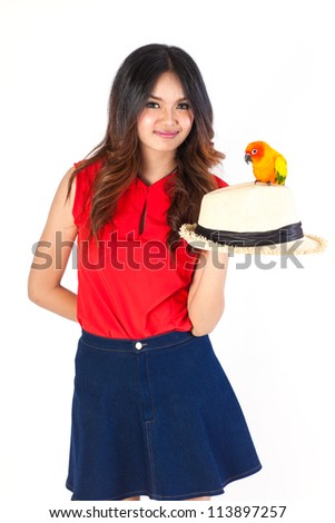 Cheeky Cockatiel parrot on the hat woman