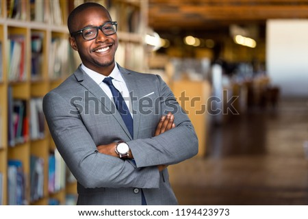 Cheerful African American educator university professor, founder, administrator, in library