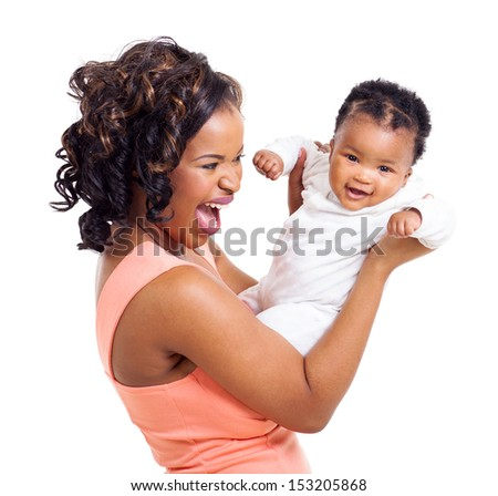 cheerful african woman playing with her little baby daughter on white background