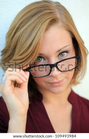 Cheerful and Confident Business Woman Wearing Eye Glasses