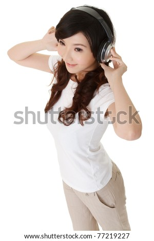Cheerful Asian woman listen music by headphone, full length portrait isolated on white background.
