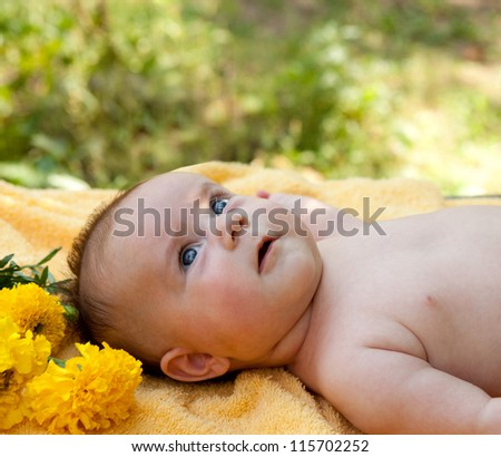 cheerful baby is resting in the garden