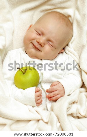 Cheerful baby with big apple