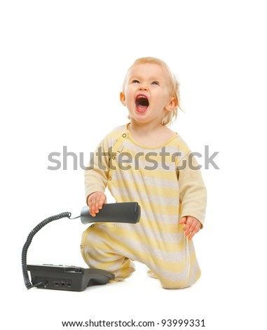 Cheerful baby with phone looking up isolated on white