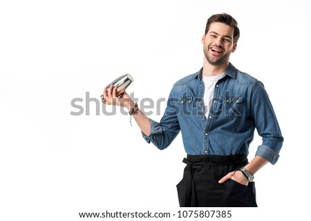 cheerful barman in apron with shaker in hand isolated on white #1075807385