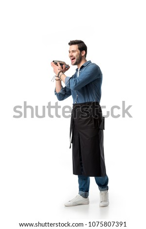 cheerful bartender in apron with shaker in hands isolated on white #1075807391