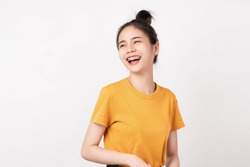 Cheerful beautiful Asian woman in a yellow shirt and stand on white background.