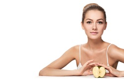 Cheerful beautiful blond girl on a diet with apple on white background. Woman smiling.