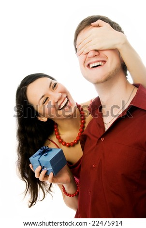 cheerful beautiful brunette woman gives a present to her husband