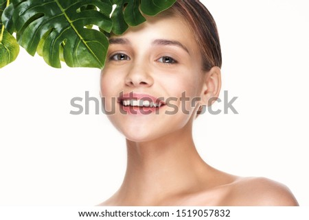 Cheerful beautiful woman charm green leaves nature beauty health