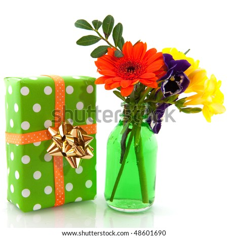 Cheerful birthday flowers and present over white
