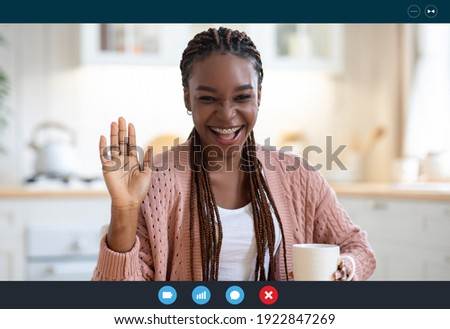Cheerful Black Woman Having Video Conference, Making Web Call While Drinking Coffee In Kitchen, African Lady Waving Hand At Camera, Greeting Somebody, Enjoying Online Communication, Screenshot View