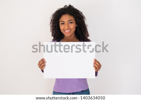 Cheerful black woman holding white banner and copy space Stock photo ©