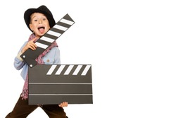 Cheerful boy holding clapper board. Different occupations. Isolated over white.