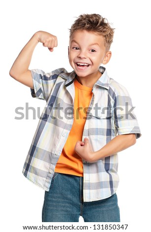 Cheerful boy in checked shirt, showing his muscles, isolated on white background
