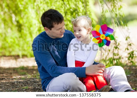 cheerful boy with his father enjoying summer time together