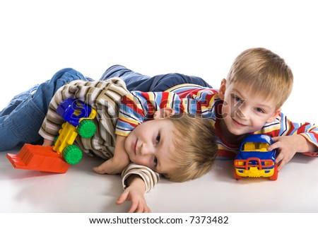 Cheerful boys lay on a floor