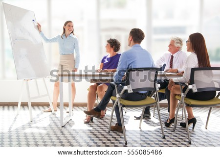 Cheerful business coach explaining strategy