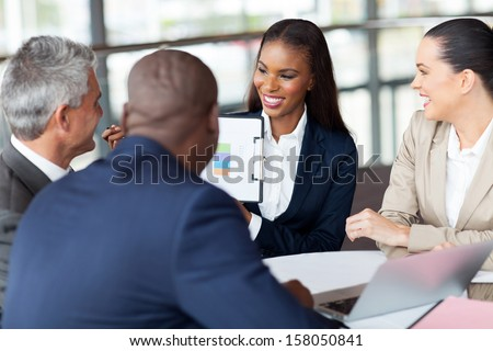 cheerful business group having monthly meeting