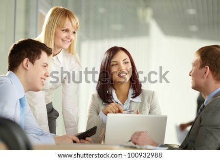Cheerful business group holding a meeting looking for new business solutions
