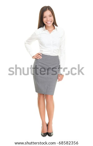 Cheerful business lady standing posing and laughing. Isolated on white background.